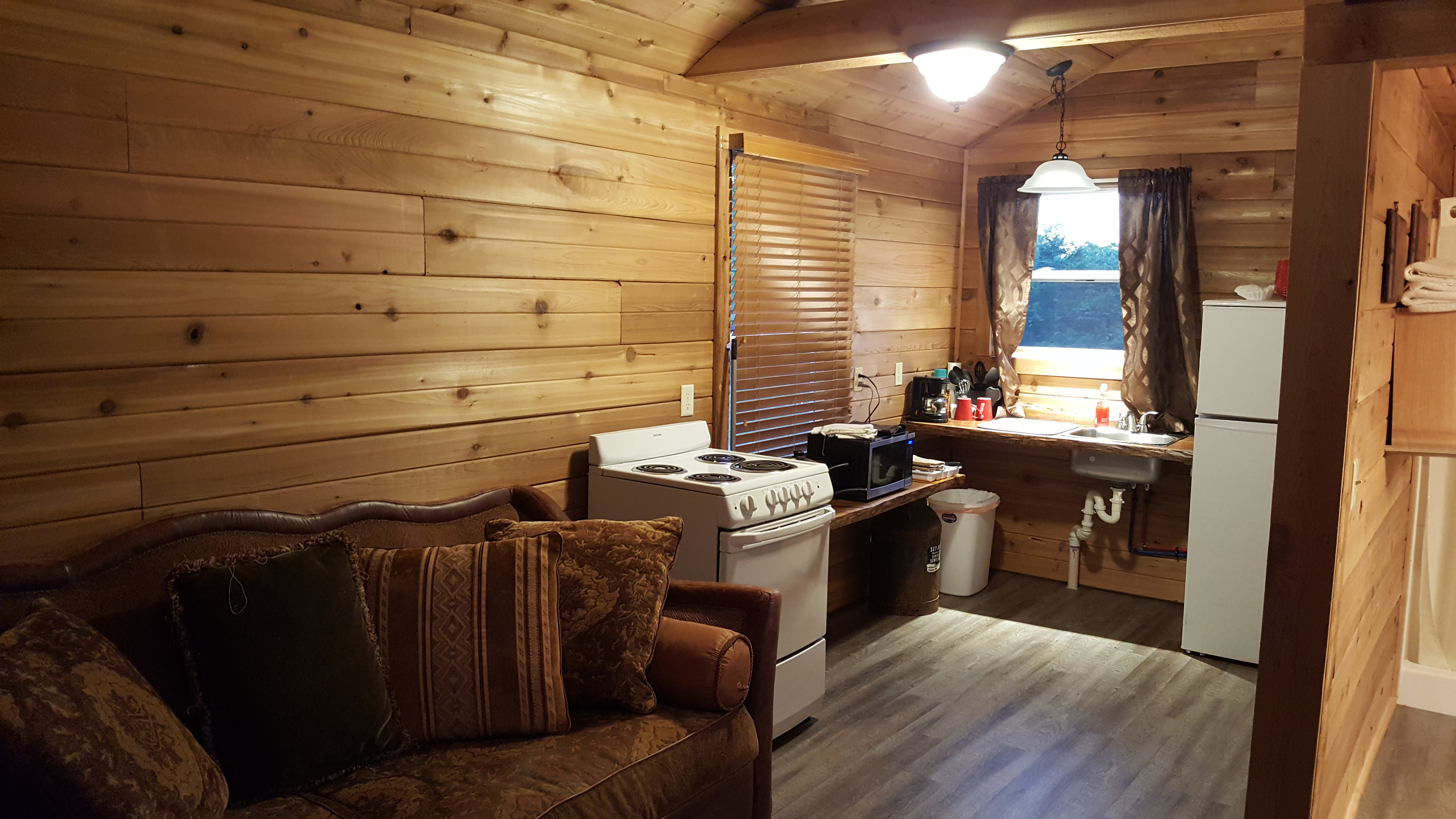 """DELUXE CABIN # 17 - $165/ 2 people, $15 each additional – (Yogi Cabin, Railroad themed) 2 full beds, 1 queen bed. Full kitchen, 32' deck. Handicap accessiblewith grab bars in bathroom, walk-in shower, wheelchair height counters and sinks and 36"""" sliding bath and bedroom doors."""