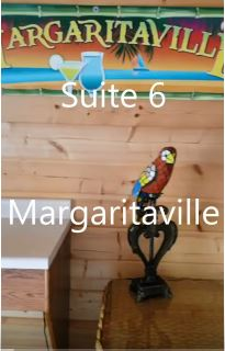 SUITE # 6 - $115/ 2 people, $15 each additional.  In Main Lodge – (Camp Mercedes) Margaritaville themed/w jacuzzi tub – Full kitchen – 2 queen beds, 1 full bed, queen sofa sleeper. 2 decks.